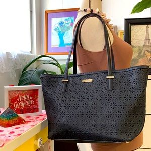 Kate Spade black eyelet leather tote with double handles.